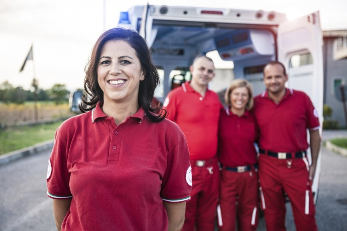 EMT-team-posing-in-front-of-an-ambulance-000035813668_Large